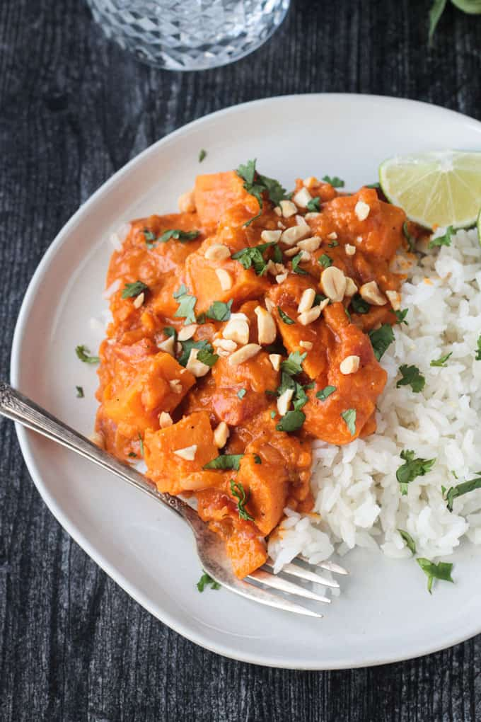 Red Curry recipe on a white plate with rice and a fork.