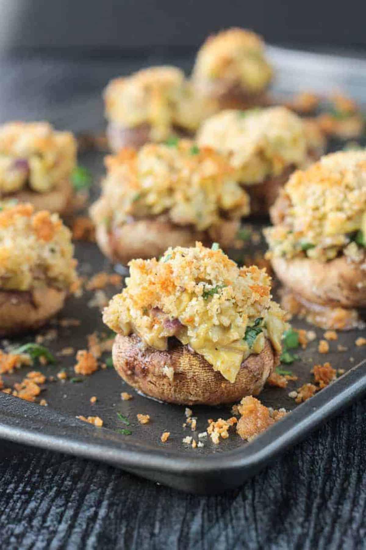 Close up of the artichoke filling in stuffed mushrooms.