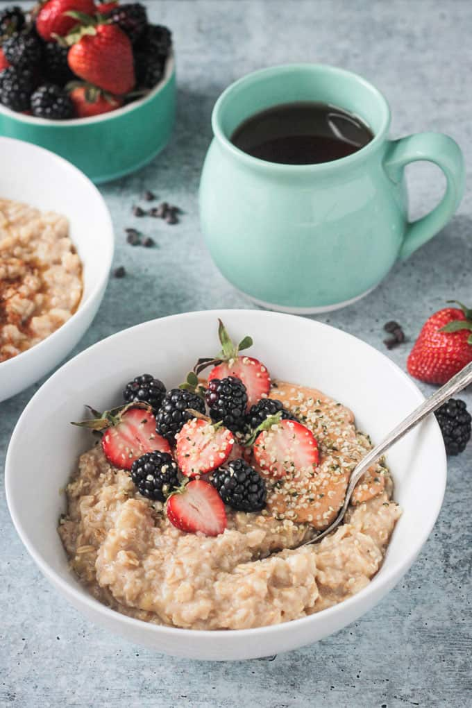 healthy oatmeal topped with fresh berries and hemp seeds
