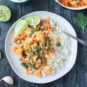 Vegetable curry on a plate with a fork.