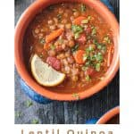 Bowl of Lentil Quinoa Soup garnished with a lemon wedge and fresh chopped parsley
