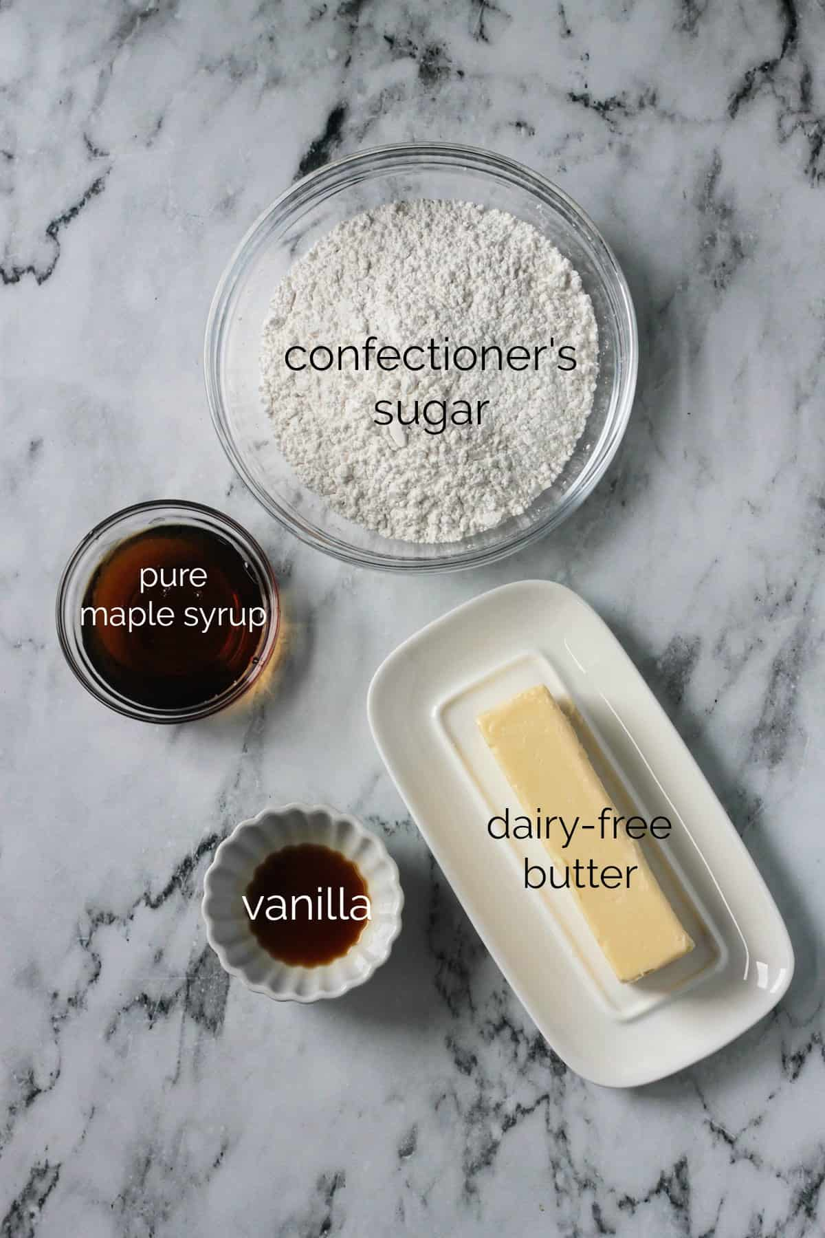Individual recipe ingredients for Maple Frosting arrayed in separate bowls.