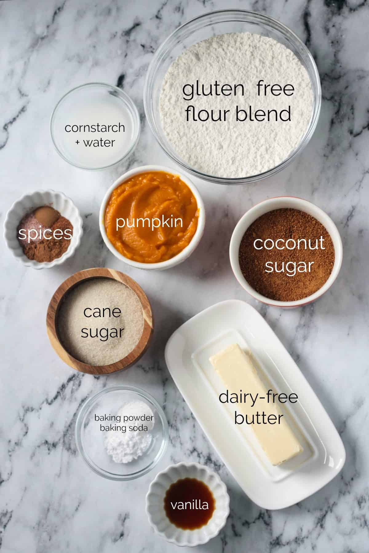 Individual recipe ingredients for Vegan Pumpkin Cookies arrayed in separate bowls.