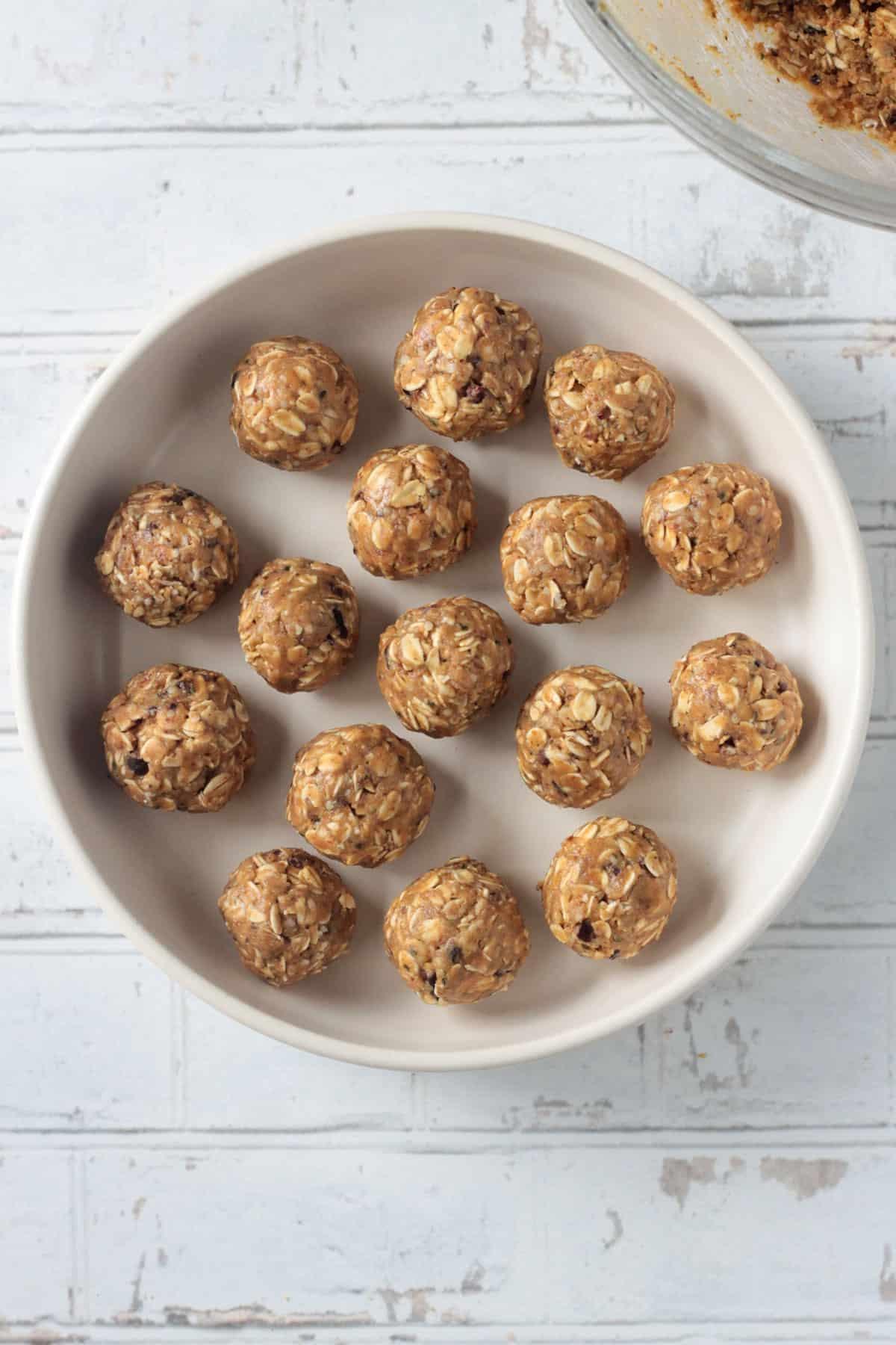 Oatmeal peanut butter balls arranged on a white plate.