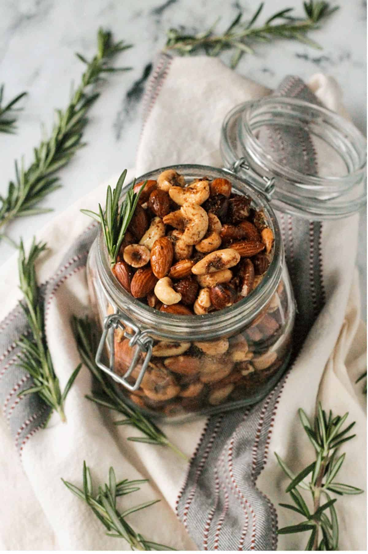 Overhead view of Spiced Roasted Nuts in an open mason jar.
