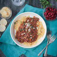 Cincinnati chili on top of spaghetti noodles