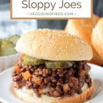 Vegan Sloppy Joes on a bun with pickles with text overlay.