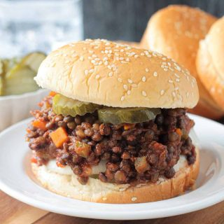 Vegan Sloppy Joes on a bun with pickles.