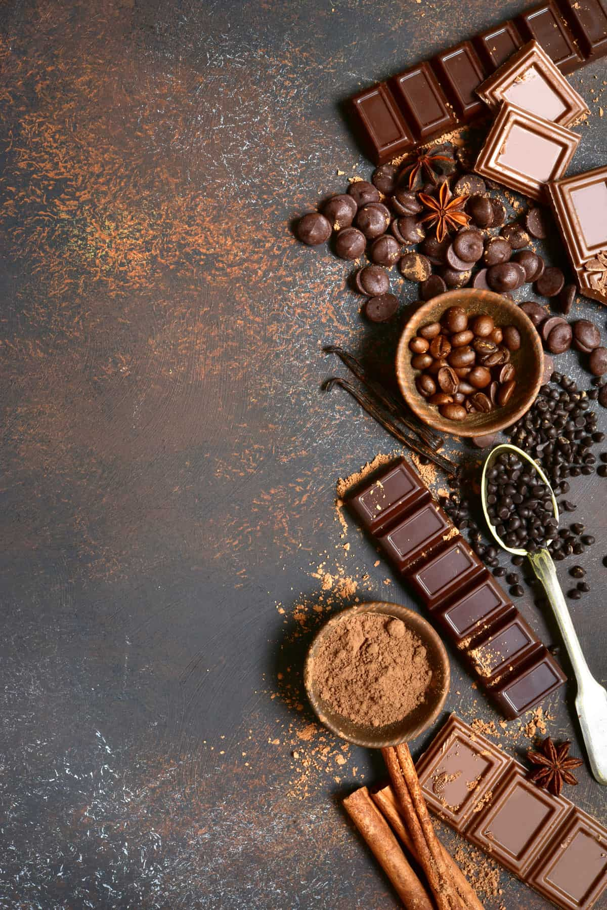 Ingredients to make vegan chocolate recipes on a gray background.