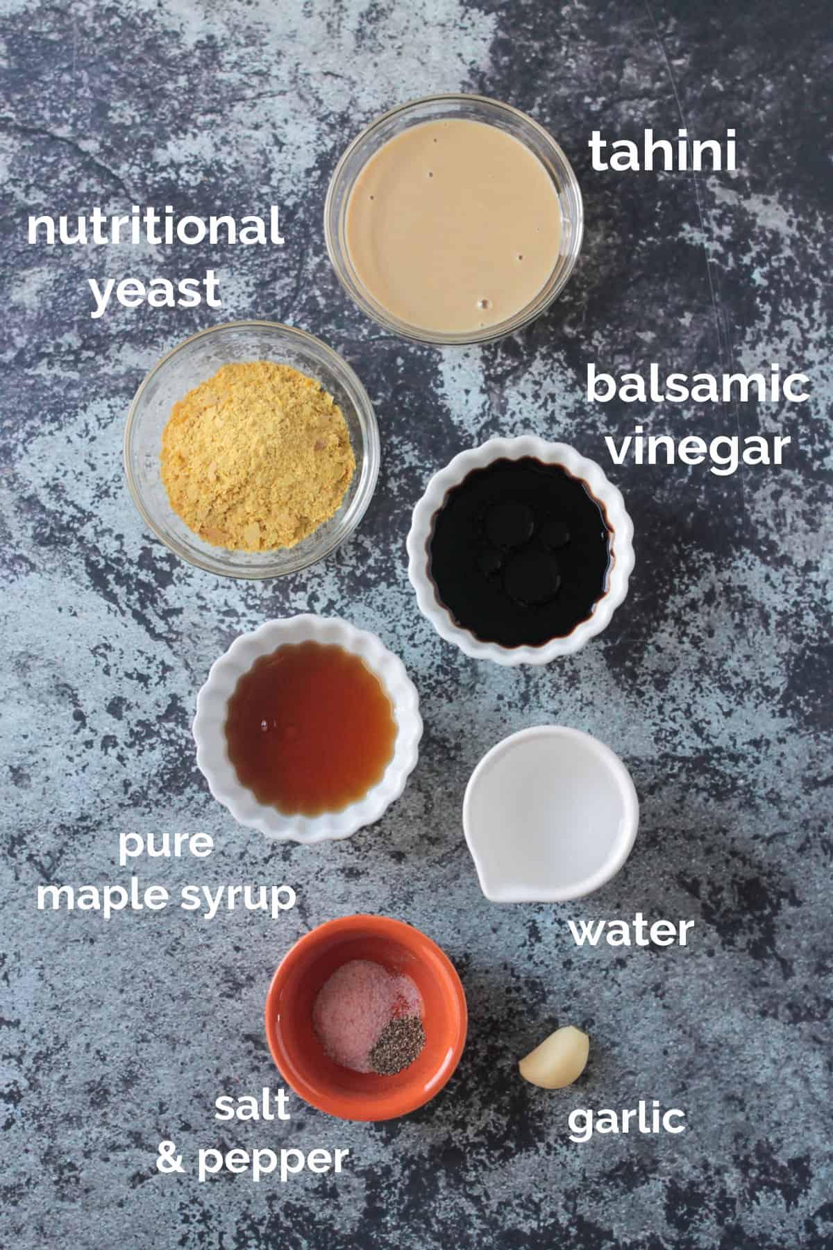 Tahini dressing recipe ingredients arrayed in individual bowls.