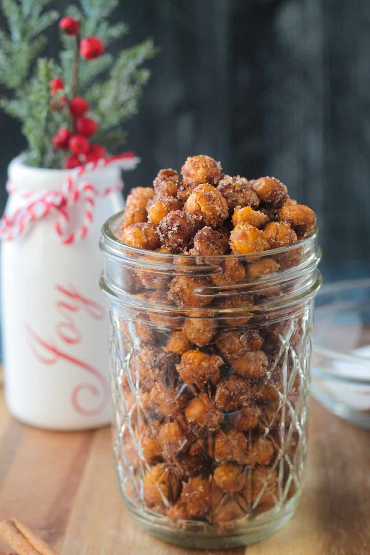 Close up view of crunchy chickpeas in a glass jar.