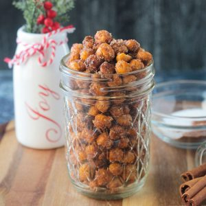 Chickpeas dusted with cinnamon sugar in a glass jar.