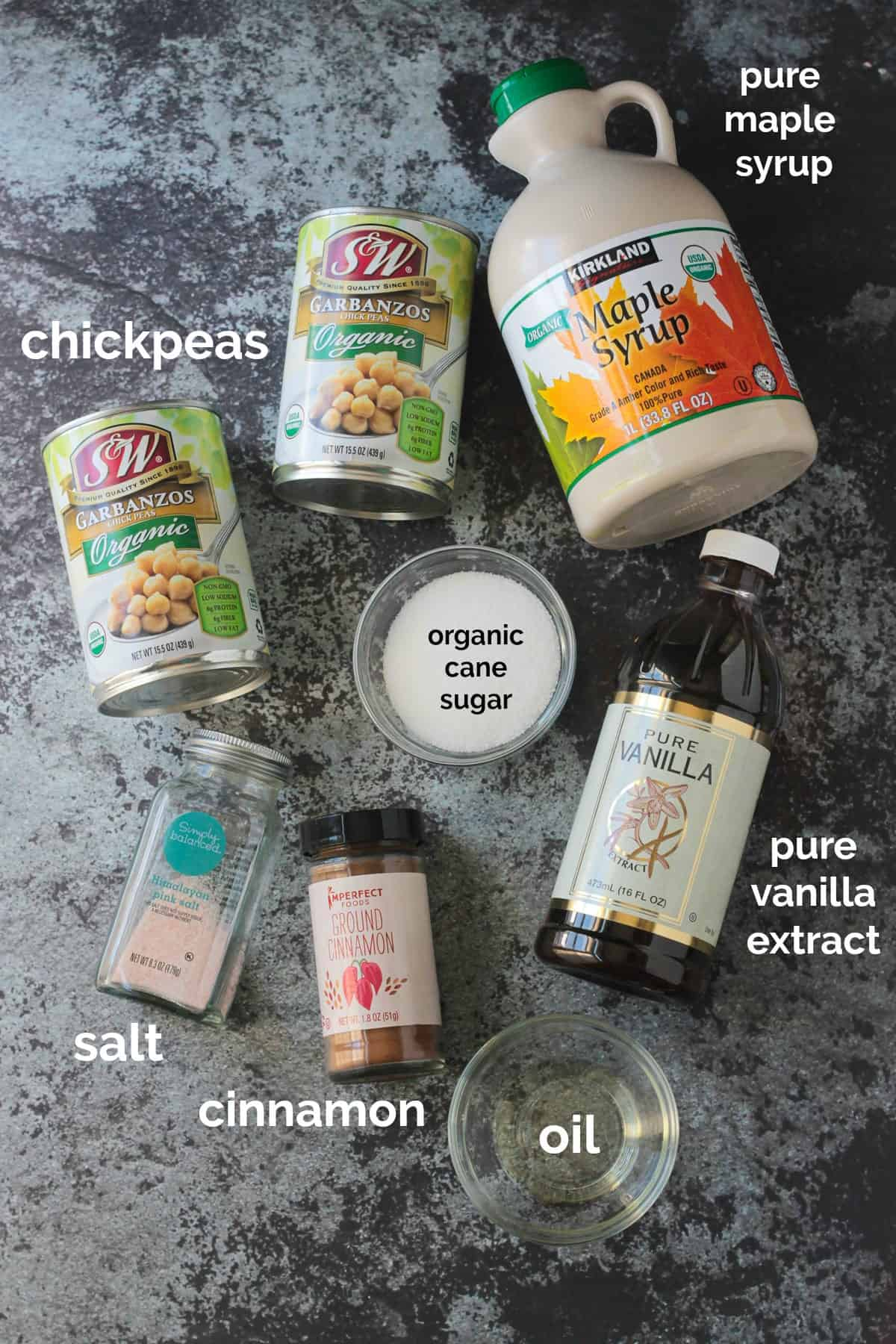 Recipe ingredients arrayed in individual bowls and containers.