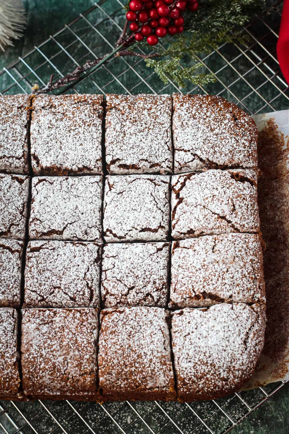 Vegan Gingerbread Cake cut into squares and dusted with powdered sugar.