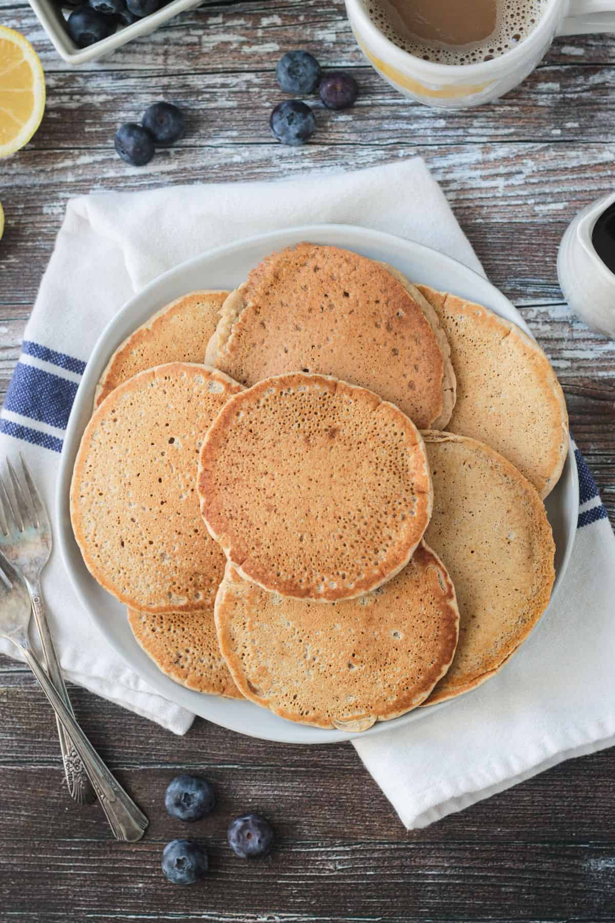 Pile of pancakes on a plate.